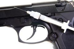 Gun and syringe Stock Image