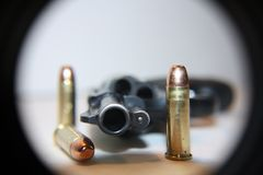 Gun on table with bullets stock photography