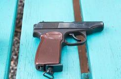 Gun on a table stock photo