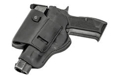 The gun in a tactical leather holster. Isolated. The gun in the holster. Isolated Stock Image