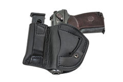 The gun in a tactical leather holster. Isolated. The gun in the holster. Isolated Royalty Free Stock Images
