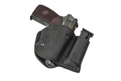 The gun in a tactical leather holster. Isolated. The gun in the holster. Isolated Stock Images