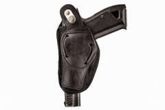 The gun in a tactical leather holster. Isolated. The gun in the holster. Isolated Royalty Free Stock Image