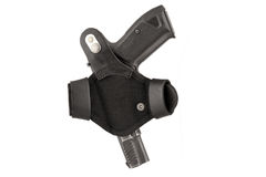 The gun in a tactical leather holster. Isolated. The gun in the holster. Isolated Stock Photo