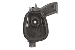 The gun in a tactical leather holster. Isolated. The gun in the holster. Isolated Royalty Free Stock Photography