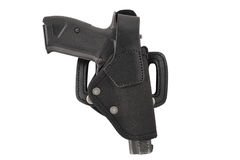 The gun in a tactical leather holster. Isolated. The gun in the holster. Isolated Royalty Free Stock Photos