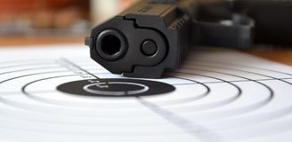 Gun and Target Stock Photo