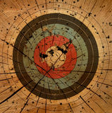 Gun Target Grunge Background. A shot up old target on an open slab of wood Royalty Free Stock Photography