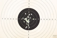 Gun target shot by bullets. White background royalty free stock photo