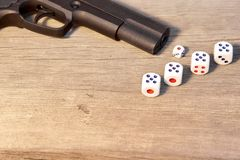Gun and three dice with number 21 on Wooden Board Stock Image