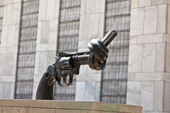Gun tied in a knot outside UN Stock Images