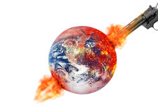 Gun to planet earth inflamed across Royalty Free Stock Photos