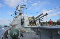 Gun Turret. A view of a the gun turret on a naval warship moored in the harbour in Gothenburg stock images
