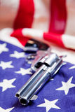 Gun Us Flag. Six shooter gun laying on United States flag Royalty Free Stock Images