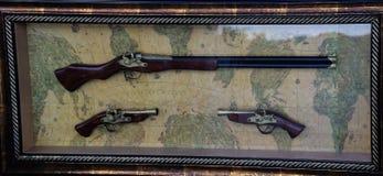 Gun on vintage map Royalty Free Stock Image