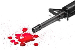 Gun violence. A M16 rifle with blood drops stock photo
