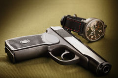 Gun and watch Stock Images