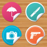 Gun weapon. Knife, umbrella and photo camera. Round stickers or website banners. Gun weapon icon.Knife, umbrella and photo camera signs. Edged hunting equipment Royalty Free Stock Images