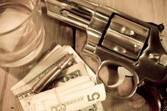 Gun and Whiskey Royalty Free Stock Photo