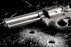 Gun With Bullet Holes In Glass Stock Images