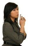 Gun woman. Pretty asian woman holding gun stock photography