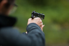 Woman holding a BB Gun ( pistol )  Royalty Free Stock Photo