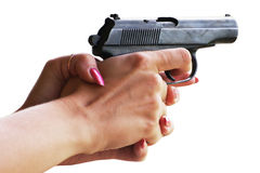 Gun in women's hands Stock Photo