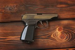 Gun on the wooden background royalty free stock photography