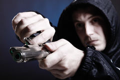 Gun in your face. Gang member prepare to shoot his enemy. Shot taken with 5d mark II and 24-70mm F2.8L Stock Images