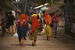 Guna Indigenous Women. PANAMA Achutupu -- Feb 1997 -- Guna women in their distinctive traditional dress walk through Achutupu during a Guna political congress stock images