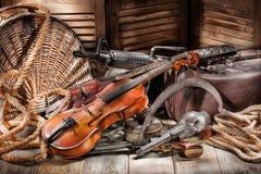 Guna a macchina e violino Immagine Stock
