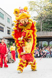 GUNAGDONG, CHINA - Nov 28 2015: Lion Dance at Foshan Ancestral T. Emple(Zumiao Temple). a famous historic site in Foshan, Guangdong, China Royalty Free Stock Photography