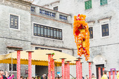 GUNAGDONG, CHINA - Nov 28 2015: Lion Dance at Foshan Ancestral T. Emple(Zumiao Temple). a famous historic site in Foshan, Guangdong, China Stock Photography
