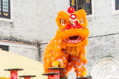 GUNAGDONG, CHINA - Nov 28 2015: Lion Dance at Foshan Ancestral T. Emple(Zumiao Temple). a famous historic site in Foshan, Guangdong, China Stock Images