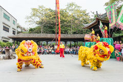 GUNAGDONG, CHINA - Nov 28 2015: Lion Dance at Foshan Ancestral T. Emple(Zumiao Temple). a famous historic site in Foshan, Guangdong, China Royalty Free Stock Images
