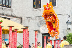 GUNAGDONG, CHINA - Nov 28 2015: Lion Dance at Foshan Ancestral T. Emple(Zumiao Temple). a famous historic site in Foshan, Guangdong, China Royalty Free Stock Image