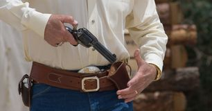 Gunbelt 3. Drawing and cocking the pistol from a western holster, ready to fire Royalty Free Stock Images