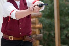 Gunfight 1. A pistol about to spew smoke and flame right after the shootist fans the hammer in a quickdraw competition Royalty Free Stock Image