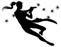 Gunfight action woman. Female heroin leaping through the air in film style gunfight action sequence Stock Image