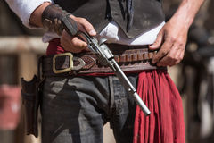 Gunfighter loading his pistol for a fight Stock Photo