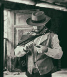 Gunfighter while scrolling tobacco Stock Photo
