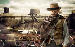 Gunfighter at the train station. Gunfighter of the wild west at the train station Royalty Free Stock Images