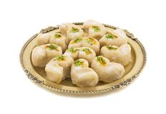 Gunja Peda or Thor peda. Indian Traditional Gunja peda Sweet Food Also Know as Thor peda Dessert isolated on White Background Royalty Free Stock Photos