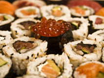 Gunkan. A huge sushi plate with a succulent ikura gunkan in the middle Royalty Free Stock Photography