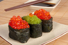 Gunkan sushi. With caviar served with soy sauce Stock Photos