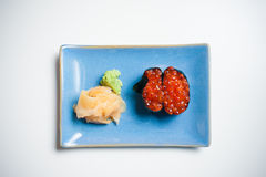 Gunkan, sushi on blue plate with ginger and wasabi Stock Image