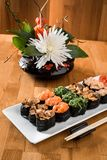 Gunkan sushi set with salmon, eel, chukka, shrimp and chicken meat on a white plate. Traditional Japanese cuisine. close up stock image