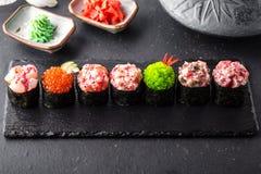 Gunkan sushi set with salmon, tuna, perch, eel, scallop, caviar, shrimp, sharp. Traditional Japanese cuisine. royalty free stock photo