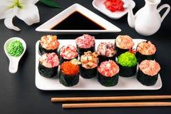 Gunkan sushi set with salmon, tuna, perch, eel, scallop, caviar, shrimp, sharp. Traditional Japanese cuisine. stock photography