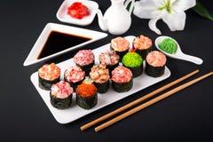 Gunkan sushi set with salmon, tuna, perch, eel, scallop, caviar, shrimp, sharp. Traditional Japanese cuisine. stock images